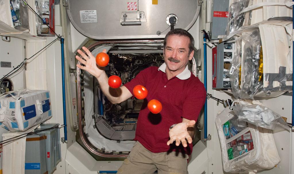 Hero iss 34 chris hadfield juggles some tomatoes