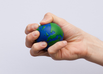 Thumb earth globe stress ball