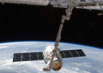 Thumb iss 31 spacex dragon commercial cargo craft is grappled by canadarm2