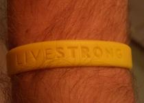 Thumb livestrong wristband worn