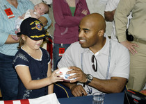 Thumb us navy 070204 n 6674h 105 new york giants running back tiki barber signs autographs for sailors aboard guided missile destroyer uss chafee  ddg 90